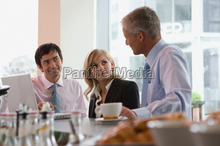 business people having meeting at bar