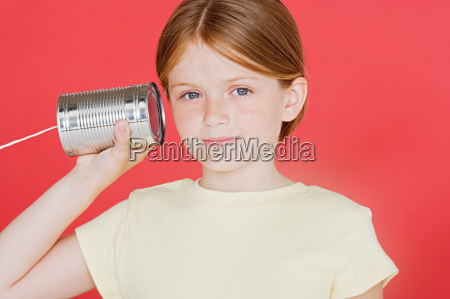 girl with tin can phone