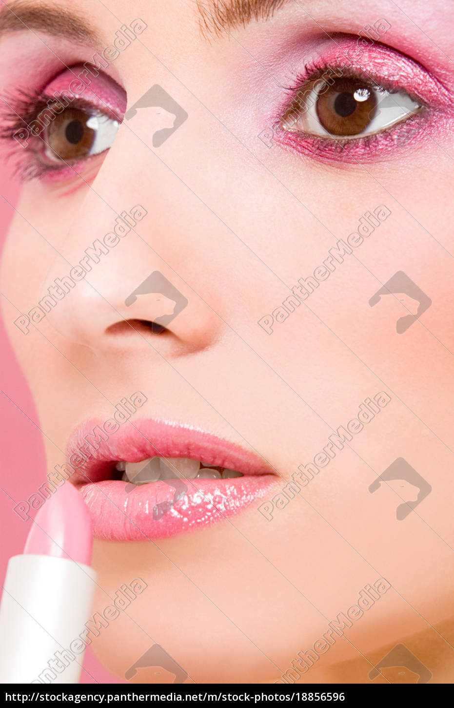woman, applying, pink, lipstick - 18856596