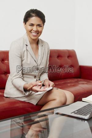 portrait of mid adult businesswoman sitting