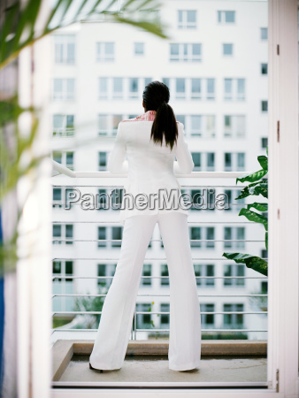 woman wearing a white suit