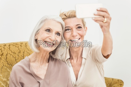 adult mother and daughter taking self