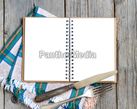 blank cooking recipe book on wooden