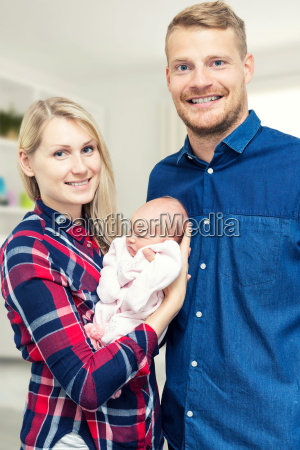 new happy family with their newborn