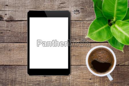 digital tablet on wood table top