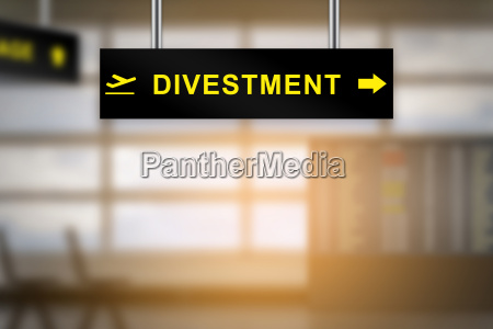 divestment on airport sign board