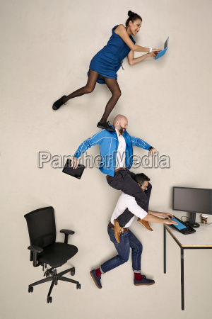 tthree business colleagues on top of