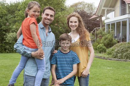 portrait of smiling family standing in
