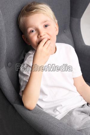 portrait of a boy sitting on