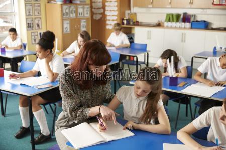 teacher helping a girl with work