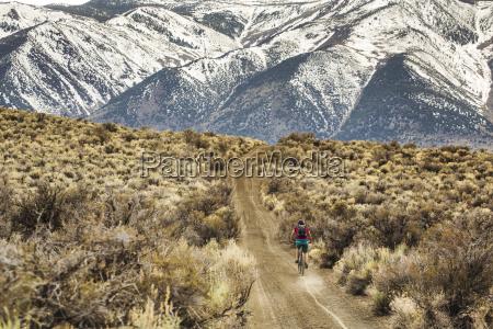 a young woman rides a mountain