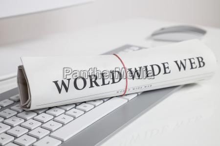 world wide web written on newspaper