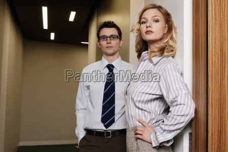 woman and man in office corridor