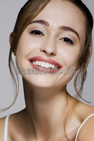 studio portrait of young beautiful smiling