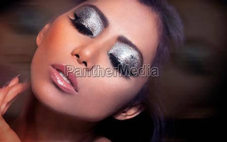 woman wearing dramatic eye makeup