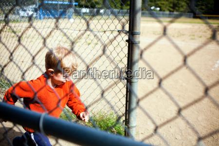 young boy running onto baseball field