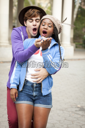 young hipster couple holding handfuls of