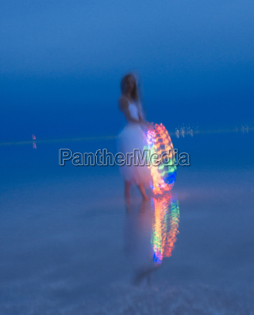 woman wearing party dress holding illuminated