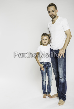 studio portrait of girl and mature