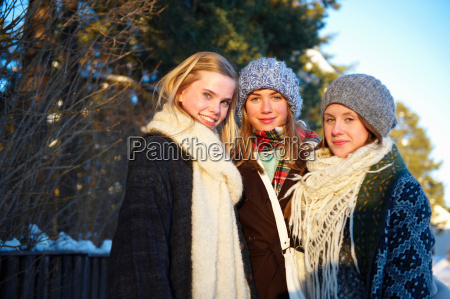 smiling teenage girls in winter clothes
