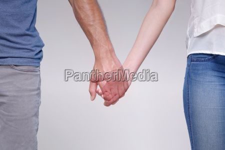 man holding hands with transparent woman