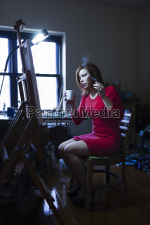 mid adult woman sitting in front