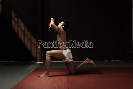 boxer kneeling on mat