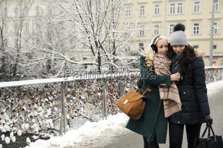 two mid adult women wearing winter