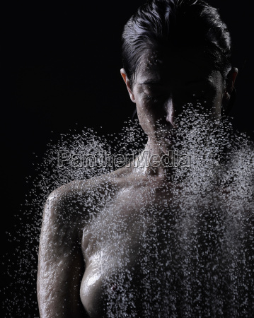 woman spraying her face in shower