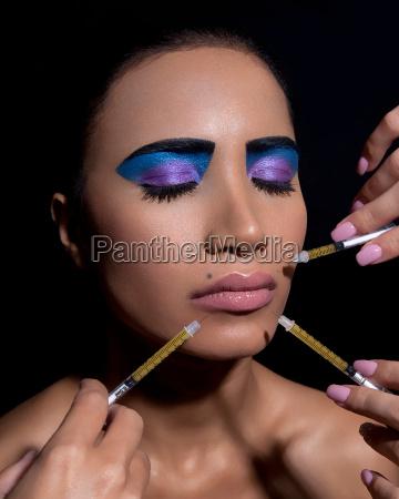 woman with dramatic eye makeup having