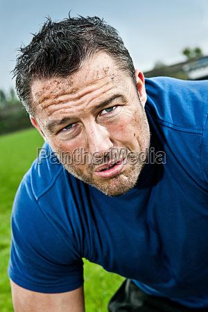 mid adult man training on pitch