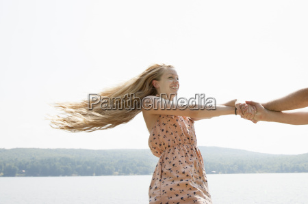 young couple holding hands woman with