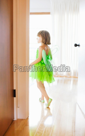 child in room with green fairy