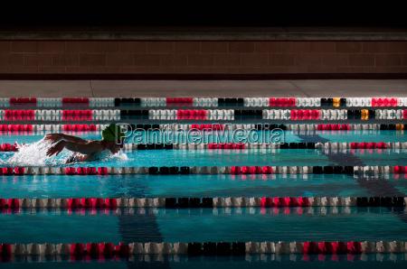 woman swimming laps in pool