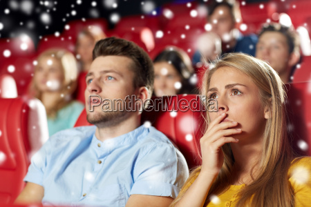 friends or couple watching horror movie