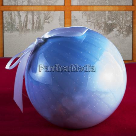 xmas tree ball over red