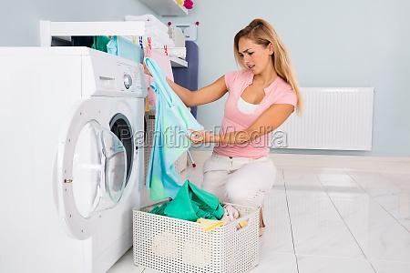 woman looking at blue t shirt