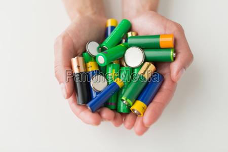 close up of hands holding alkaline