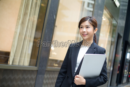 asian business woman hold with laptop