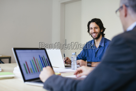 two businessman working together in office