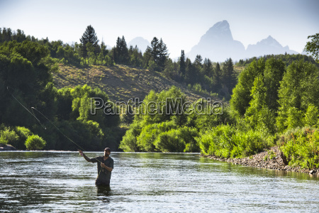 a fly fisherman in the gros