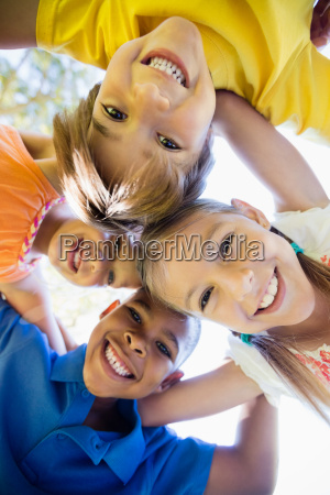 smiling children forming a huddle in