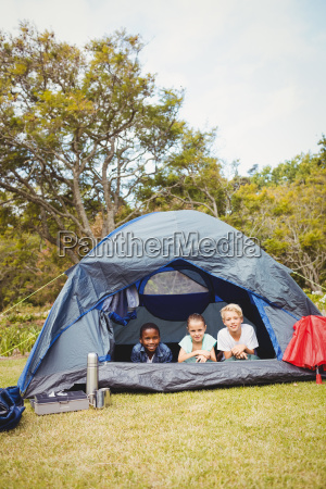 smiling children lying in the tent