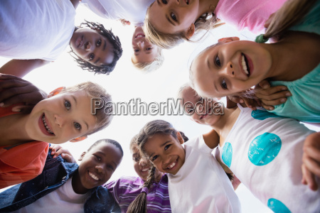 kids posing together during a sunny