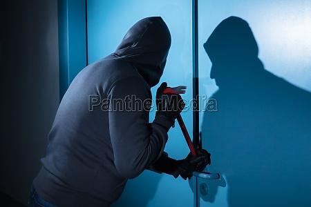 puerta robo palanca construccion ladron