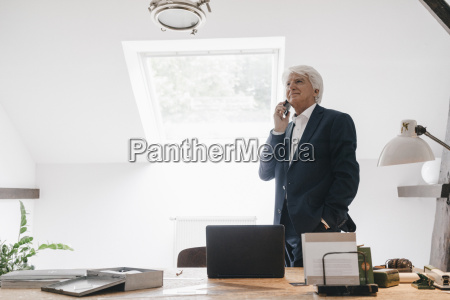 senior businessman on the phone in
