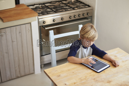 young boy using tablet computer in