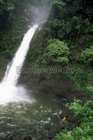 tourists swimming in falls la paz