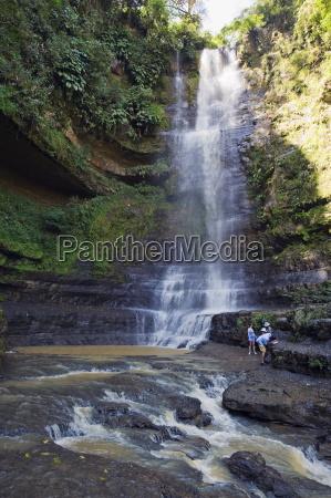 tourists at juan curi waterfall san