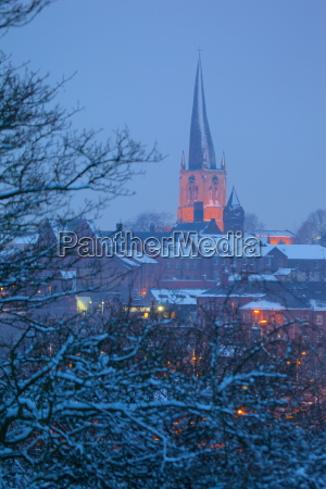 view of town and crooked spire